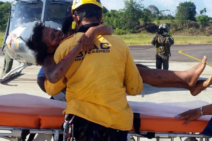 'MIRACLE' SURVIVORS: In what some have hailed as a miracle, Ms Nelly Murillo (above, being carried by a rescue worker) and her infant son survived a plane crash in a dense jungle in Colombia that claimed the pilot's life. The 18-year-old mother and h