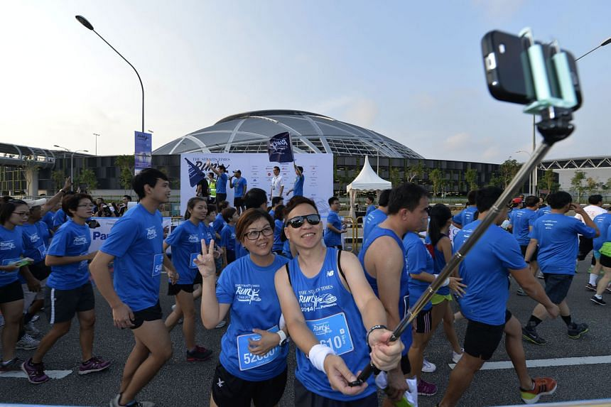 Participants taking a selfie at The Straits Times Run at the Hub last September. This year, runners can choose to sign up for a 5km fun run, a 10km competitive run or an 18.45km celebratory route to mark ST's 170th anniversary. All runners will get t
