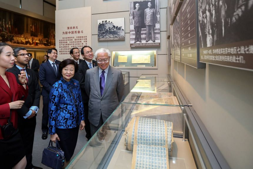 Singapore President Tony Tan Keng Yam and his wife Mary being given a tour of the National Museum of China yesterday.