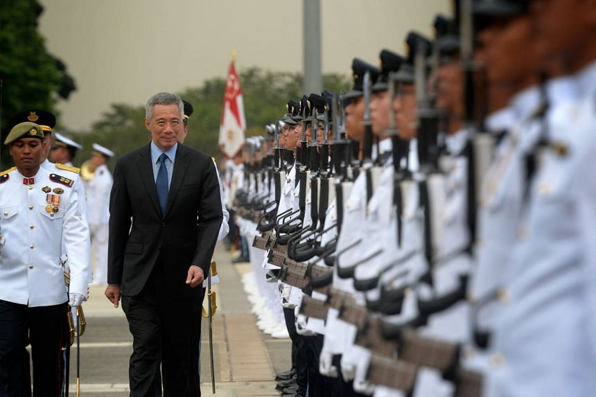 Yesterday's SAF50 Parade, which commemorated the five decades of the Singapore Armed Forces' existence, was officiated by Prime Minister Lee Hsien Loong. Unlike the usual annual SAF Parades, this year's event saw the attendance of pioneer SAF troops,