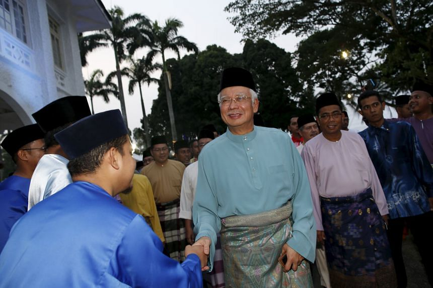 Mr Najib Razak (centre) arriving at a break fast event in Johor yesterday. The opposition has called on him to step aside to allow an independent probe into media allegations of corruption.