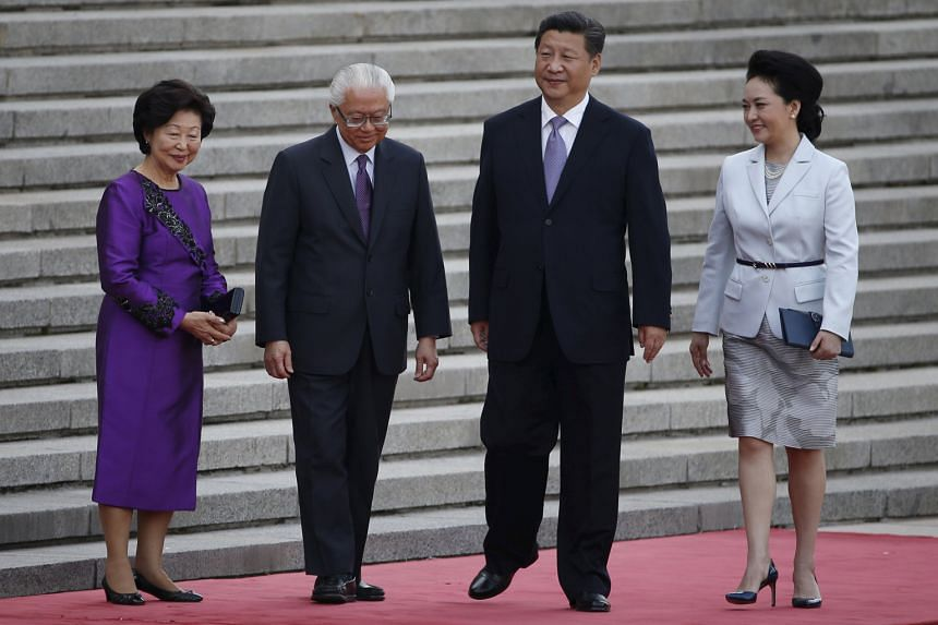 Singapore President Tony Tan and his wife Mary with Chinese President Xi Jinping and his wife Peng Liyuan at a ceremony outside the Great Hall of the People in Beijing on Friday. Dr Tan stressed that the Republic has to evolve to deal with the changi