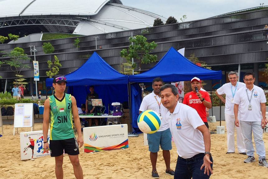 Dr Vivian Balakrishnan, Minister for the Environment and Water Resources, hitting the first serve at the beach volleyball competition during the two-day OCBC WaterFest at the Singapore Sports Hub yesterday. About 15,000 people turned up to soak in th