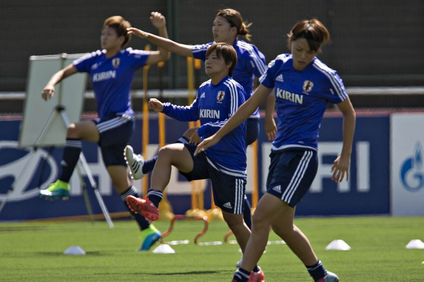 Shonobu Ohno (centre) and her Japan team-mates (from left) Saori Ariyoshi, Rumi Utsugi and Nahomi Kawasumi warming up at training during the Women's World Cup in Vancouver. Forward Ohno is central to Japan's fluid attacking play that places an emphas