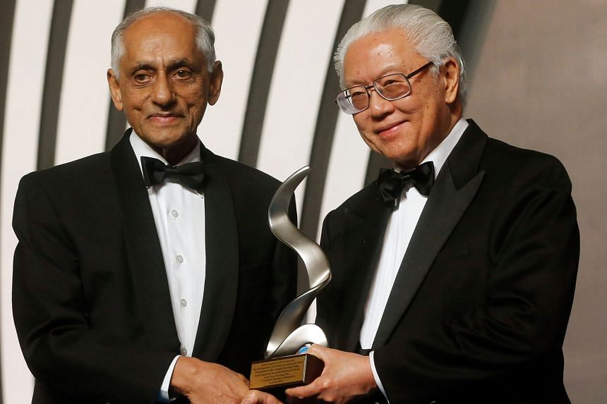 President Tony Tan Keng Yam presenting the special distinguished contribution to corporate governance award to Mr J.Y. Pillay, chairman of the Council of Presidential Advisers, yesterday.