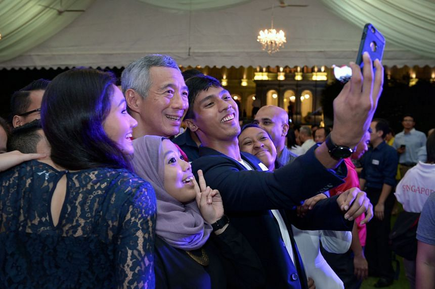 (Clockwise from above): At the Istana Garden Party, taking a wefie with Prime Minister Lee Hsien Loong; Deputy Prime Minister Teo Chee Hean snapping the Quah siblings; and Minister Lawrence Wong performing on the guitar.