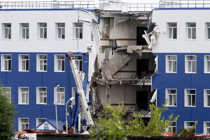 The section of the military barracks just outside the Siberian city of Omsk that collapsed on Sunday night. A probe into negligence, violation of safety rules and abuse of power will be carried out.
