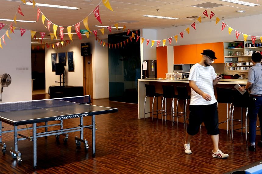 The central meeting point in the Ubisoft office is a large open pantry that comes with a game lounge and a ping-pong table.