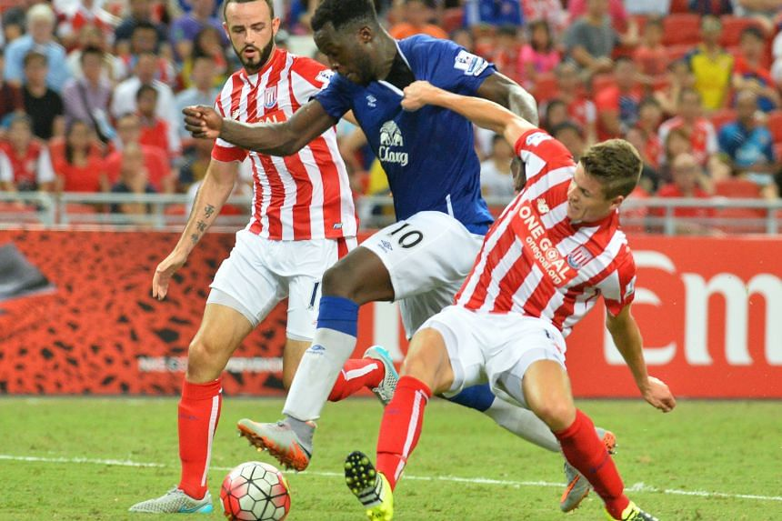 "Everton's Romelu Lukaku (centre) being challenged by Stoke's Marc Wilson (left) and Marco van Ginkel during their Barclays Asia Trophy opener. Stoke manager Mark Hughes praised his team for their ""accomplished performance"", saying that ""collectively"