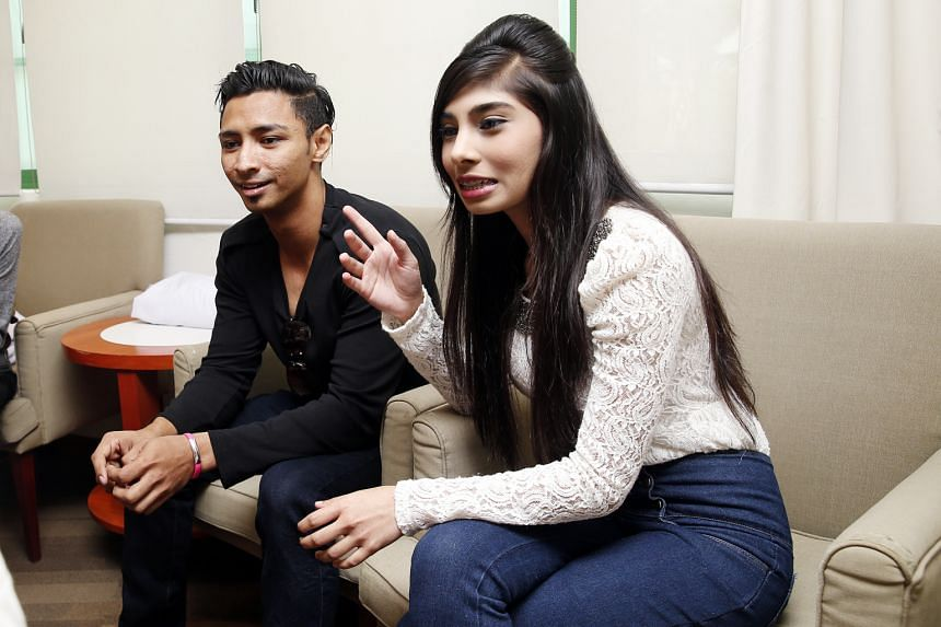Mr Muhammad Hanafie Ali Mahmood, seen here with girlfriend Nabilah Nasser, drew praise for standing up to a bully on the train.