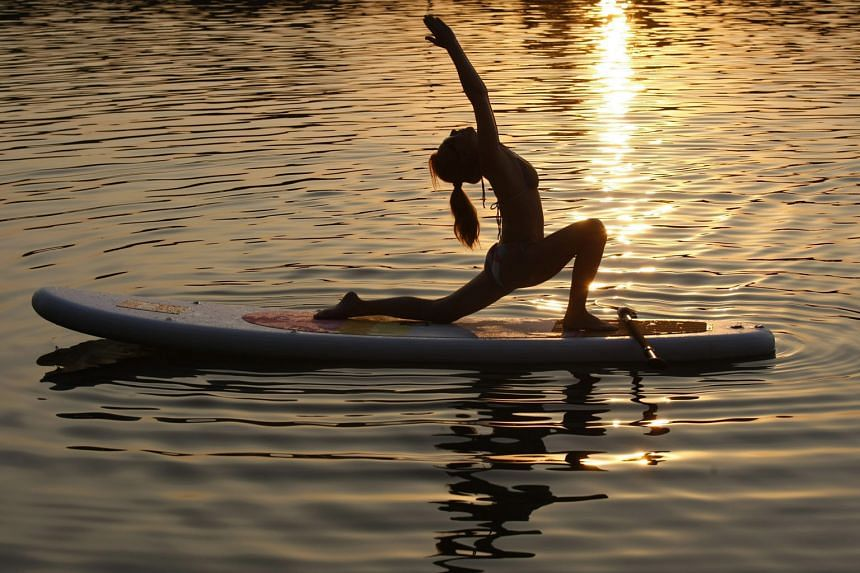 """Owing to rising living standards, yoga is a lifestyle option that the writer now regards as a """"must have""""."""