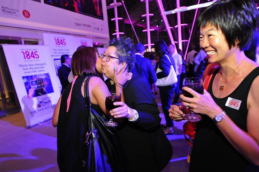 (Right) Former reporter Arti Mulchand planting a friendly peck on copy editor Irene Hoe, as former reporter Karen Wong looks on. (Centre) ST editor Warren Fernandez, political editor Paul Jacob and former business correspondent Gerry de Silva. (From