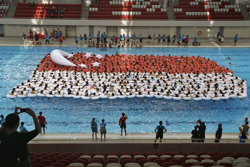 With their ring floats, 500 students got together yesterday in an attempt to set the record for Largest Floating Singapore Flag during a full rehearsal for the SG50 event Youth Celebrate! at the Singapore Sports Hub's OCBC Aquatic Centre. Minister fo