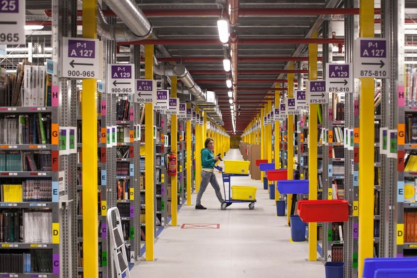 A worker at the Amazon.com fulfilment centre in Poznan, Poland. Amazon shares jumped as much as 19 per cent after it reported on Thursday that second-quarter revenue rose 20 per cent to US$23.2 billion (S$31.8 billion).