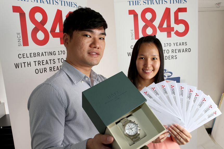 Avid watch collector Jerome Tan won the classic Ball Trainmaster Racer worth $5,050 while Ms Lim Mei Shen walked away with the Mitsubishi Cool Treats package worth $10,000. ST PHOTO: WANG HUI FEN