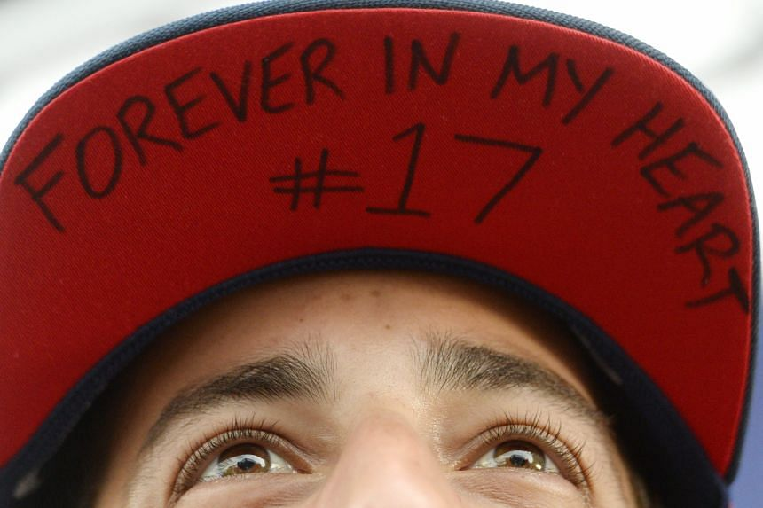 Red Bull driver Daniel Ricciardo with an inscription on his cap honouring the late driver Jules Bianchi, at the Hungaroring circuit.