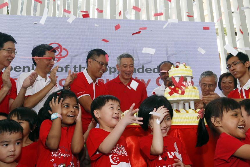 Children cheering as PM Lee celebrated the reopening of the Nee Soon East Community Club with MPs from the constituency, including Mr Patrick Tay (on PM Lee's right) and Mr K. Shanmugam (right).