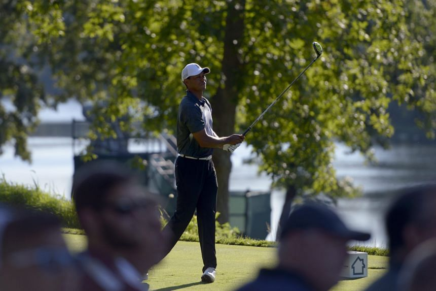 Former world No. 1 Tiger Woods, now languishing outside the top 250 in the rankings, teeing off on the 13th hole during the second round of the Quicken Loans National. While his latest swing changes have not borne fruit, he has putted aggressively an