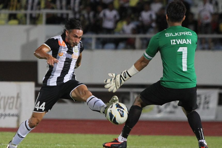 Issey Nakajima-Farran scoring past LionsXIl goalkeeper Izwan Mahbud to give Terengganu a 3-1 lead in their MSL match in Kuala Terengganu. The 4-2 win puts the hosts into sixth place on 26 points, with the Singapore team just behind on goal difference