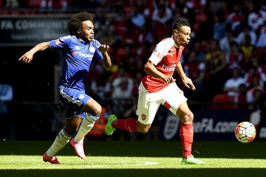 Arsenal's Francis Coquelin (in red) gaining ground on Chelsea's Willian during last week's Community Shield. The emergence of the Frenchman has stemmed the Gunners' urge to go out and sign a holding midfielder.