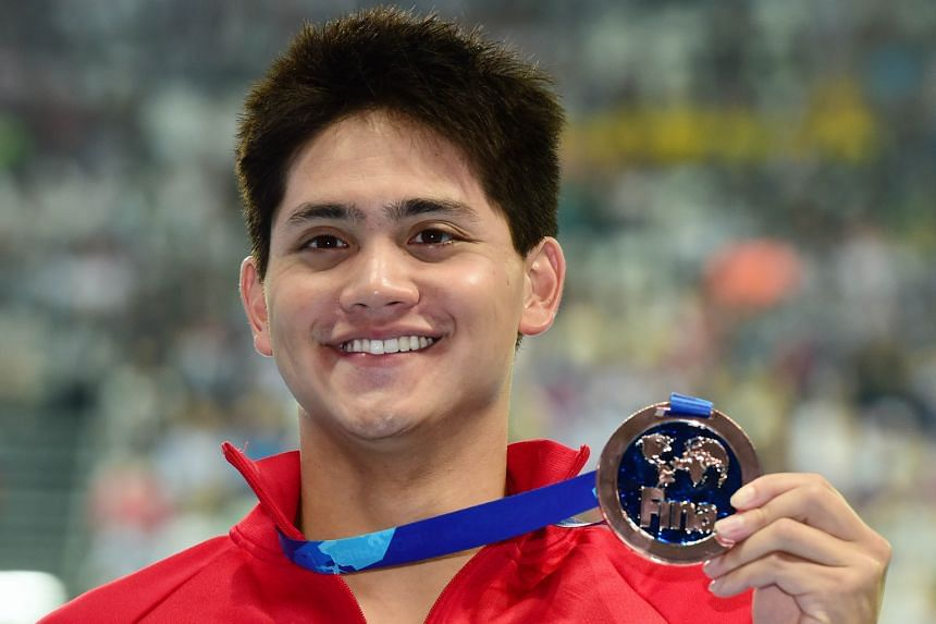 Joseph Schooling with his bronze medal for the 100m butterfly at the world championships yesterday. He clocked 50.96sec, a new Asian record, as he finished behind Chad le Clos (50.56) and Laszlo Cseh (50.87).