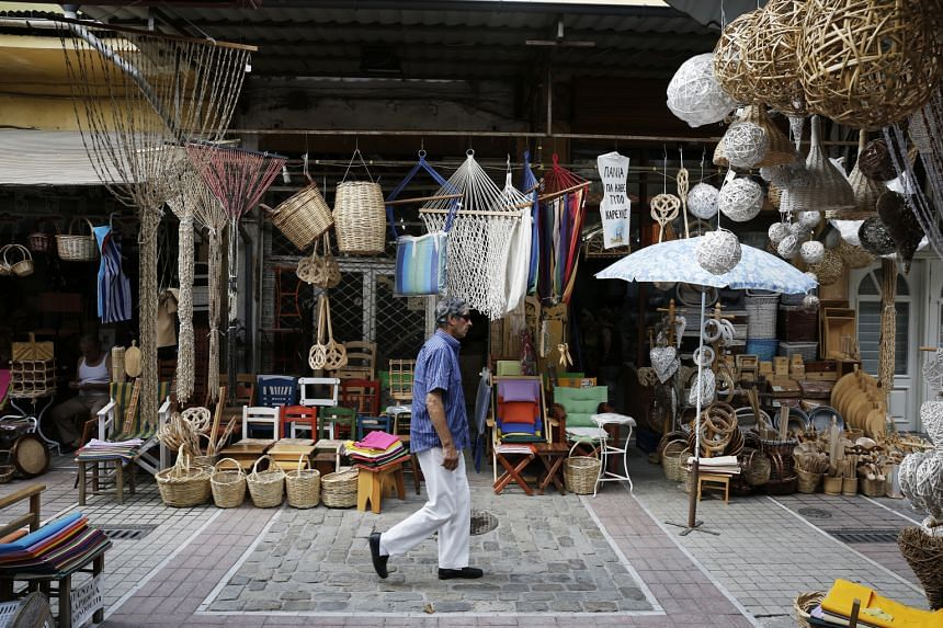 """An empty handicrafts store in Thessaloniki, Greece's second-biggest city. Economists cautioned that the country's second-quarter growth figures should be taken with a """"grain of salt""""."""