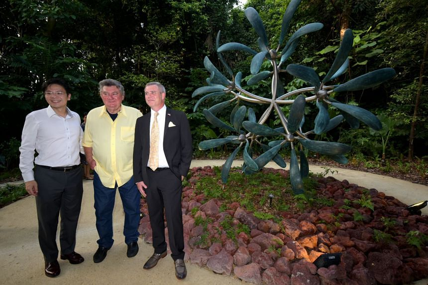 From left: Minister for Culture, Community and Youth Lawrence Wong, artist James Surls and US Ambassador to Singapore Kirk Wagar at the unveiling of the sculpture Fifty Wings in the Botanic Gardens yesterday.