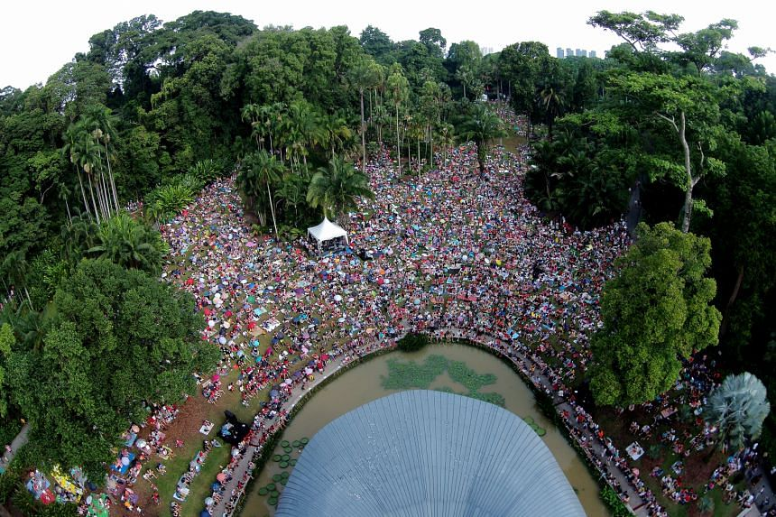 Visitors enjoying a concert at the Botanic Gardens over the jubilee weekend. Since the Gardens obtained its Unesco World Heritage Site status last month, it has seen a 35 per cent rise in the number of visitors.