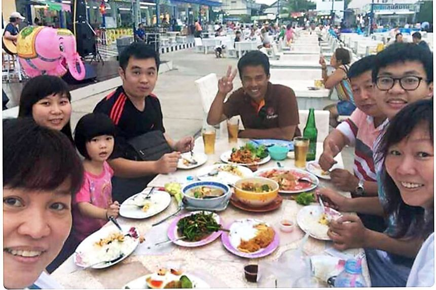 Members of the Teoh family having a meal with their Thai driver in Bangkok. The family later visited the Erawan Shrine. Only Ms Neoh Ee Ling (second from left) and her father Neoh Hock Guan (third from right) survived the attack.