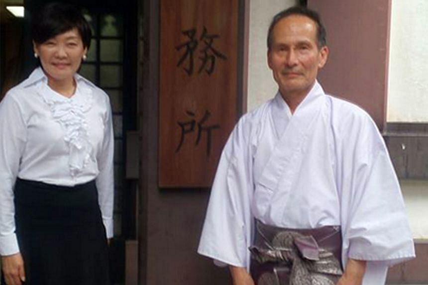 Mrs Akie Abe posted a picture of herself standing next to a senior priest at the Yasukuni shrine on Tuesday.