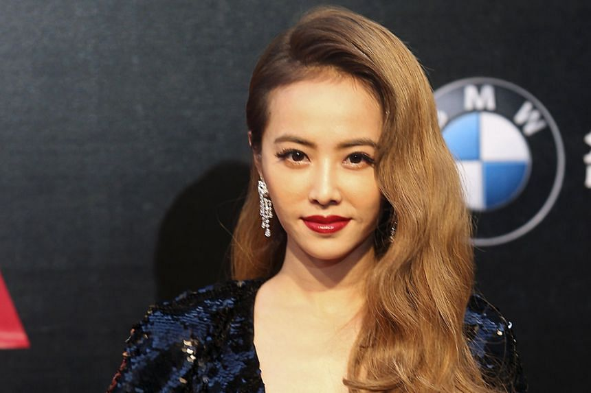 Singer Jolin Tsai (left) makes a bold statement with her deep-red lips.