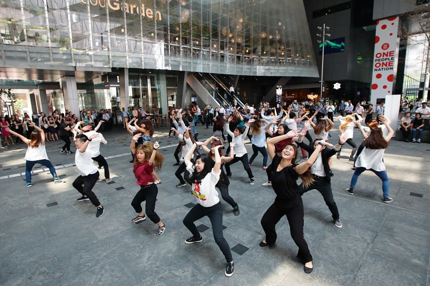 Dancers from O School dance school perform a mass dance at Asia Square at an event to launch Got To Move yesterday.