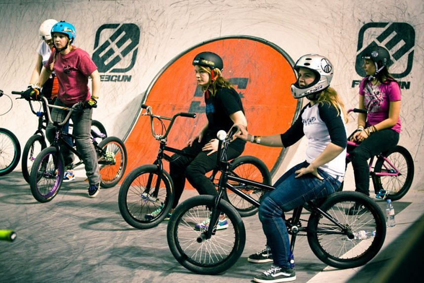 One of the films featured include Sister Session (2012, left) which follows an all-female team's foray into a bicycle motocross event.