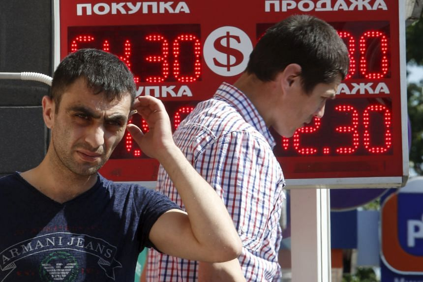 At Arina's Hangout, a tiny shop near the train station in Ramenskoye, sales are down by almost half. Russians are experiencing the first sustained decline in living standards in the 15 years since Mr Putin came to power. The rouble has fallen by half