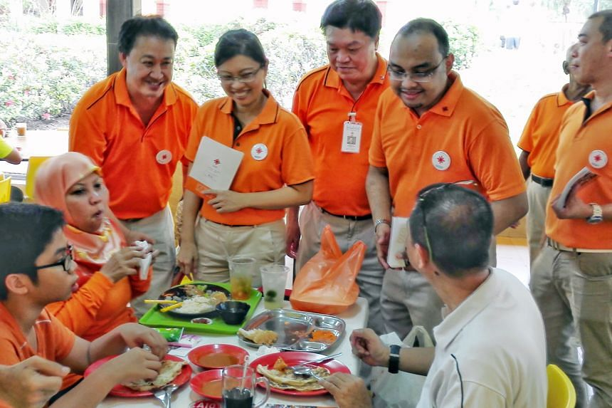 Ms Hazel Poa (standing, second from left), with (from left) NSP member Lim Tean, president Sebastian Teo and party member Mohamed Fazli Talip during a recent walkabout in Tampines East. Ms Poa is the third NSP secretary- general to resign this year.