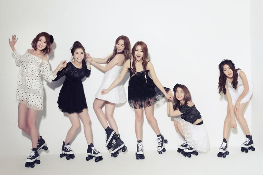 K-pop girl group Dal Shabet, comprising (from far left) Kaeun, Woohee, Serri, Jiyul, Ayoung and Subin, are headlining this Saturday's NTU Fest concert. Dal Shabet member Jiyul with local actress Julie Tan, who has recommended the group local delicaci