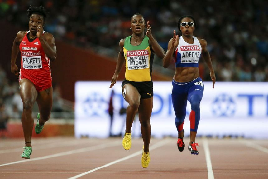Jamaica's Veronica Campbell-Brown (centre) and Margaret Adeoye running in the same lane at the end of the women's 200m heats yesterday. Campbell-Brown started in lane five but, after the bend, she lost her bearings and crossed into the Briton's lane