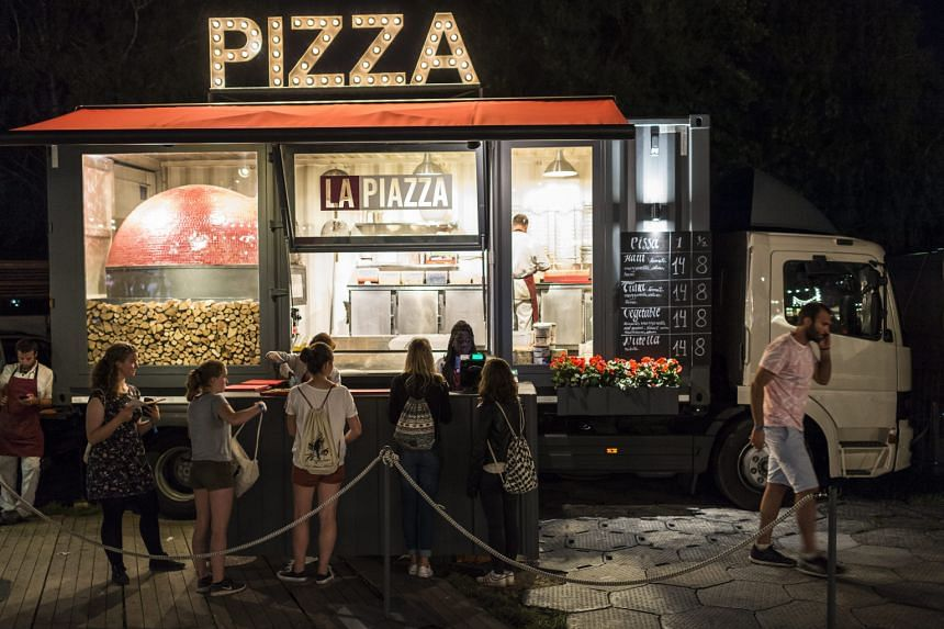 A pizza truck in Zurich. Helping to feed the 0.2 per cent growth in the second quarter was the economy's strong resilience in digesting the franc's appreciation.
