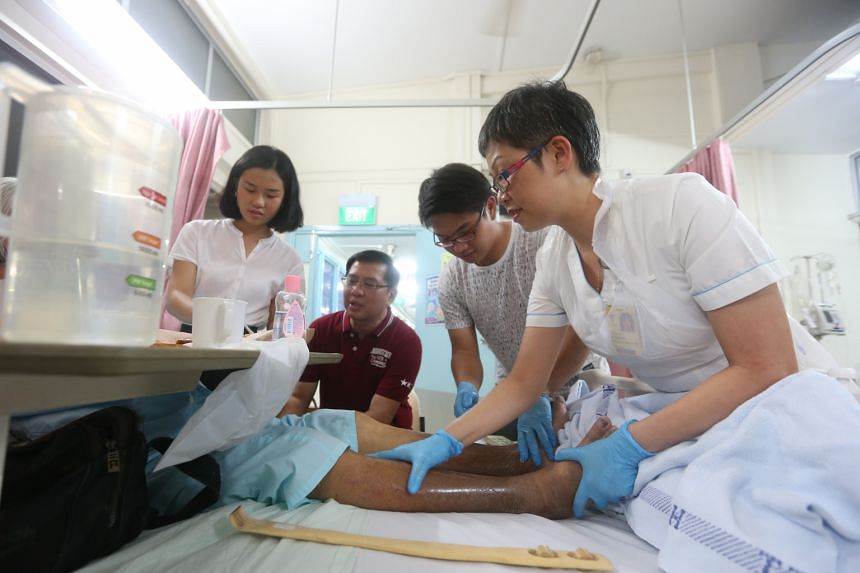 Madam Yeoh (right) and her family - (from left) daughter Tan Yi Ping, husband Tan Teow Heng and son Tan Zhi Yang - have been volunteering at the Patient Care Centre since 2009.
