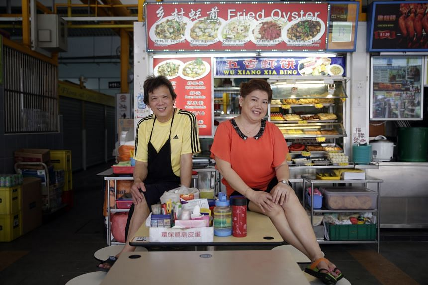 Ms Annie Tan, stall owner of Fried Oyster, and her assistant Mr Goh Peng Huan at 85 Fengshan Centre.