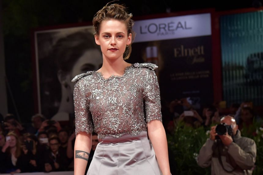 Kristen Stewart arriving for the screening in competition of Equals in Venice. Eddie Redmayne (above) plays transsexual pioneer Lili Elbe in The Danish Girl that opened at the Venice Film Festival.