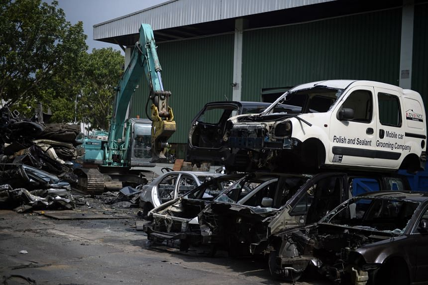 A car scrapyard in Sungei Kadut. Deregistered vehicles are supposed to be scrapped or exported, but falling overseas demand could be one reason why some motor traders risk not putting their deregistered cars in an export-processing zone, which charge