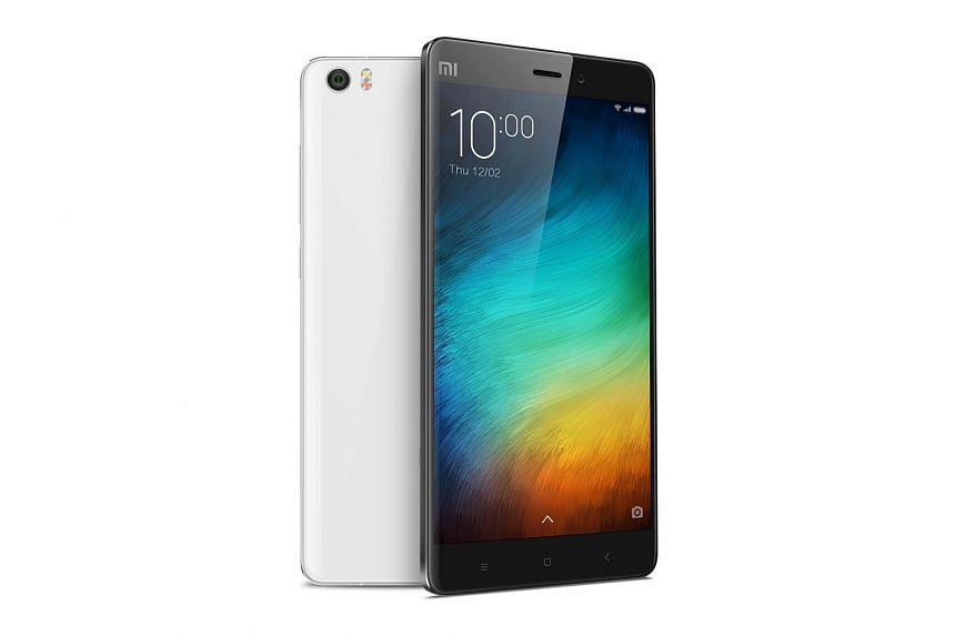 The Mi Note's glass and metal body has a curved rear and thin body.