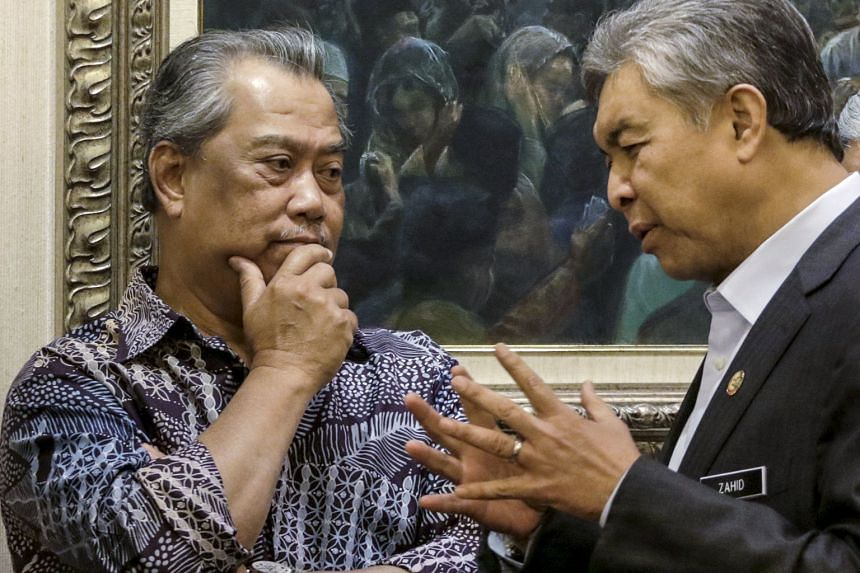 Deputy Prime Minister Zahid Hamidi (at right) speaking yesterday with his predecessor, Tan Sri Muhyiddin Yassin, who was dropped from the Cabinet in July.