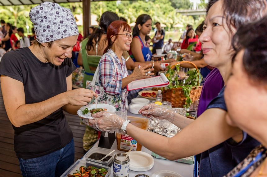 #SgEatWithUs is a movement encouraging people to bond over home-cooked meals, such as at a carnival they participated in at Orto, formerly known as Bottle Tree Park.