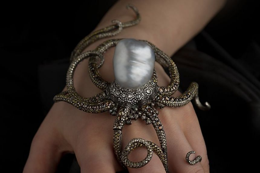 Sevan Bicakci (left) took more than a year to craft Kraken (above); one of his intricately carved rings (top).