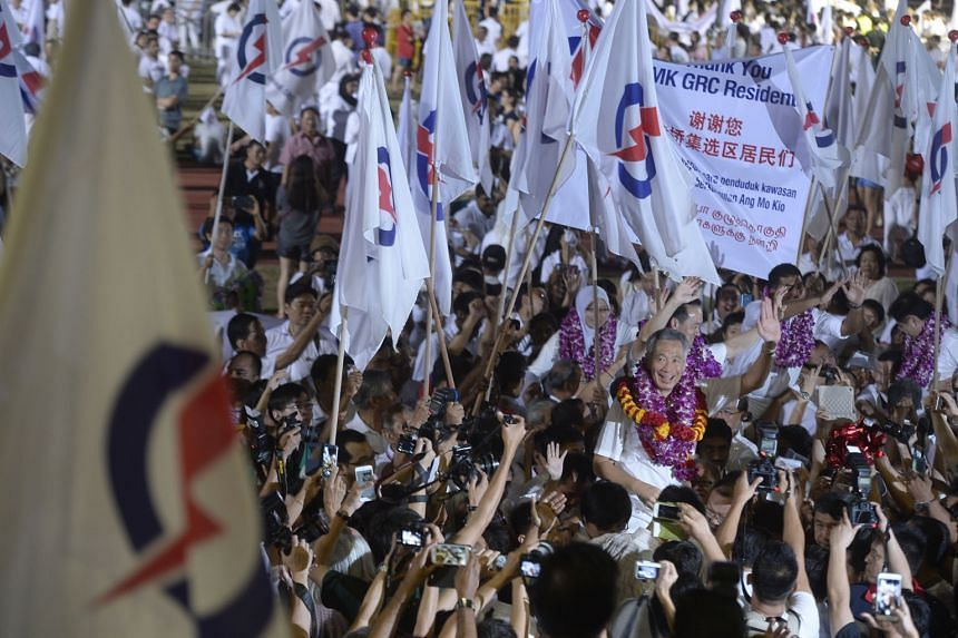 PM Lee Hsien Loong and his Ang Mo Kio GRC team celebrating their win with PAP supporters at Toa Payoh Stadium. Mr Lee thanked voters and said the results show Singaporeans know what is at stake, and are also an endorsement of the policies and the per