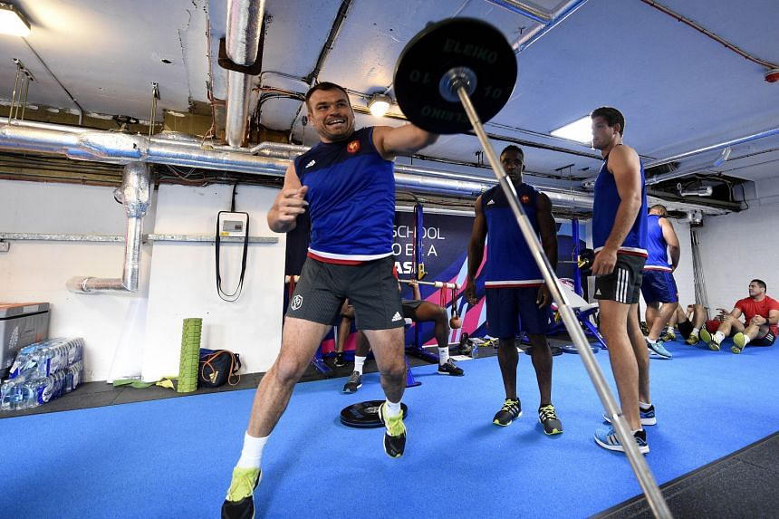 France's rugby union players lifting weights during an indoor training session at the Trinity School in Croydon, south London, ahead of the World Cup, which starts on Friday. World Rugby head Bernard Lapasset says banned substances are the biggest da