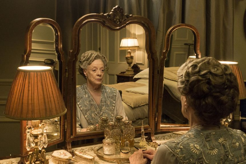 Dame Maggie Smith in Downton Abbey (left). The trick of the series is for it to be very densely plotted so that there are lots of different stories going on, says creator Julian Fellowes.