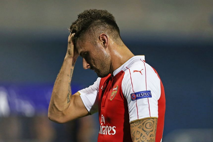 Arsene Wenger is adamant that Olivier Giroud (above) should not have been red-carded against Dinamo Zagreb. While three of the four EPL teams lost their opening Euro group games, Wenger says it is still early days.
